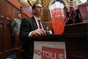 Rep. Doug Dubitsky, R- Chaplin, protests Governor Ned Lamont's proposed highway tolls and tax on sugared drinks during the budget address to the general assembly at the Capitol in Hartford, Conn. on Wednesday, February 20, 2019.