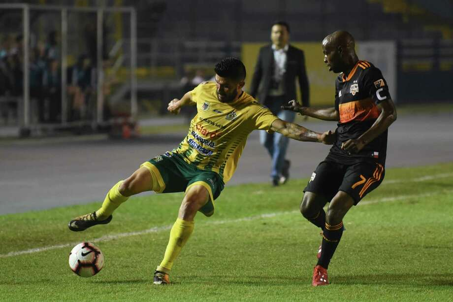 Guatemalas Guastatoya Aaron Navarro (L) vies for the ball with US Houston Dynamo Damarcus Beasley during their Concacafs Champions League football match at the Doroteo Guamuch stadium in Guatemala City on February 19, 2019. (Photo by JOHAN ORDONEZ / AFP)JOHAN ORDONEZ/AFP/Getty Images Photo: JOHAN ORDONEZ, AFP/Getty Images / AFP or licensors