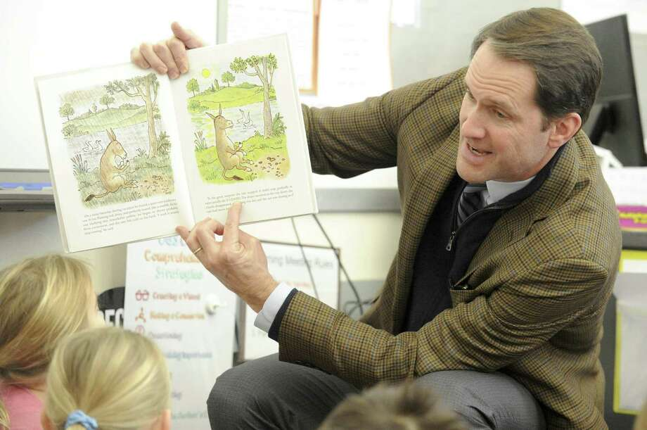 U.S. Rep. Jim Himes, D-Conn., with Greenwich students during the town's World Read Aloud Day event on Feb. 1. Photo: Matthew Brown / Hearst Connecticut Media / Stamford Advocate