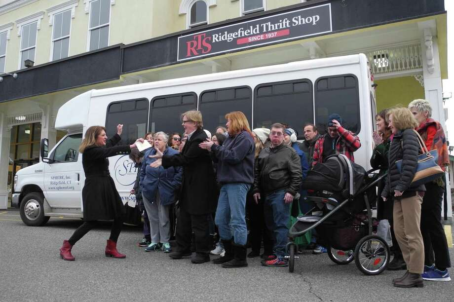 SPHERE members celebrate receiving a check from the Thrift Shop in February 2018. The money covered SPHERE's operating costs on its bus last year. Photo: Macklin Reid / Hearst Connecticut Media / Ridgefield Press