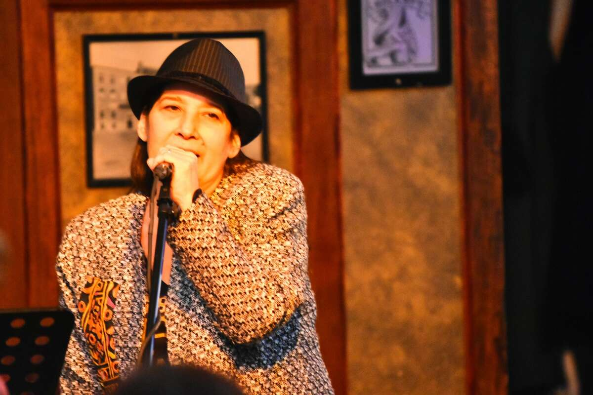 Caroline Isachsen, known by her stage name MotherJudge, at McGeary's Pub in  Albany on Jan. 9, 2019, during the Best Damn Open Mic Ever, which she has hosted for years.