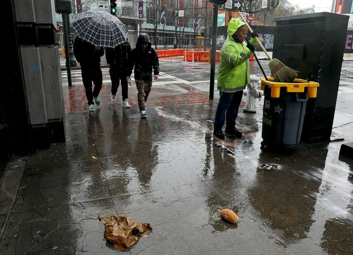 "Kenneth Leon, a Corridor Ambassador for the Department of Public Works, cleans a section off of Market St. in San Francisco, Calif., on Thursday, February 14, 2019. Corridor Ambassadors, a city program, hires people to clean specific, high traffic blocks around business corridors. ""As of October, when I first got out here, every day was a mess and it was just dirty. It was a constant battle,"" Leon said. ""In the last three months, I've noticed that since they've got all these different companies out here helping cleaning, that the city's been staying a lot cleaner and it's made a big difference. And I just hope it stays that way."""
