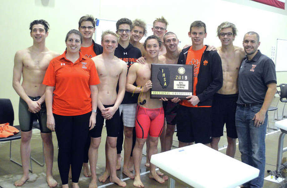 The Edwardsville boys' swim team poses with the championship plaque after winning the team title in Saturday's Edwardsville Sectional at Chuck Fruit Aquatic Center. Photo: Scott Marion/Intelligencer