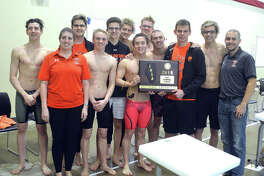 The Edwardsville boys' swim team poses with the championship plaque after winning the team title in Saturday's Edwardsville Sectional at Chuck Fruit Aquatic Center.