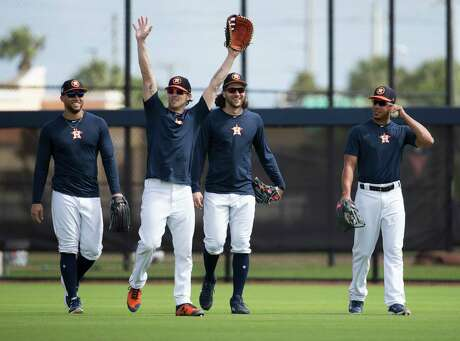 Houston Astros right fielder Josh Reddick, second left, waves to live batting practice hitters at the end of a session with fellow outfielders George Springer, from left, Jake Marisnick and Michael Brantley at Fitteam Ballpark of The Palm Beaches on Day 7 of spring training on Wednesday, Feb. 20, 2019, in West Palm Beach.