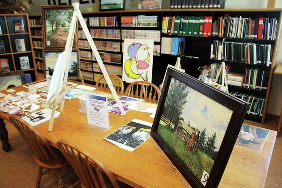 Paco paints traditional scenery, portraits, mixed media and linear abstract art -- and works with oil, acrylic, ink and pencil. (Seth Stapleton/Huron Daily Tribune)