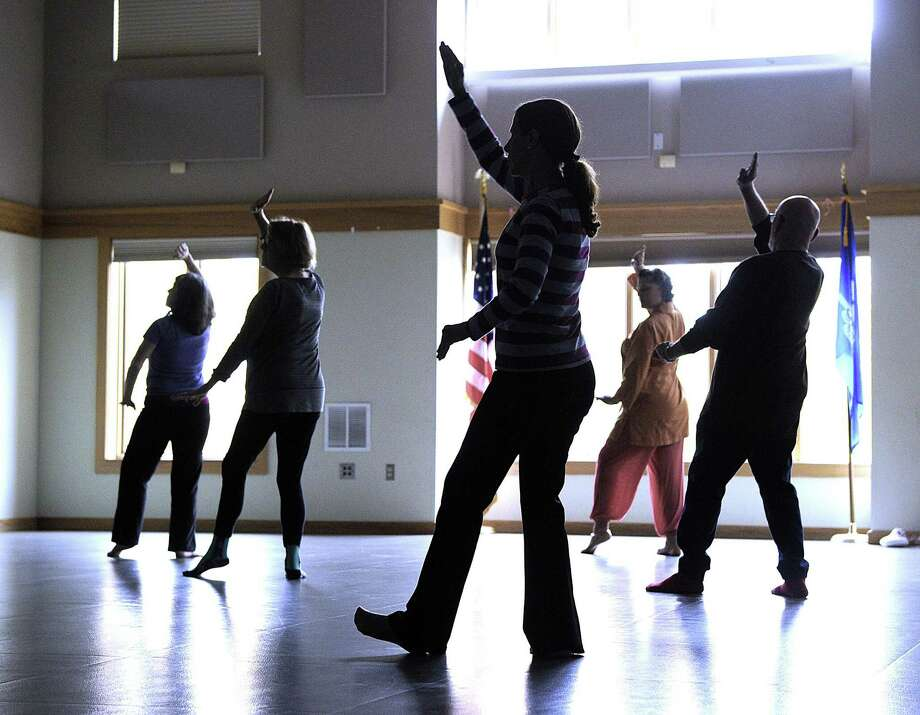 File photo of a Tai Chi class at the Redding Community Center. Photo: Carol Kaliff / Hearst Connecticut Media / The News-Times