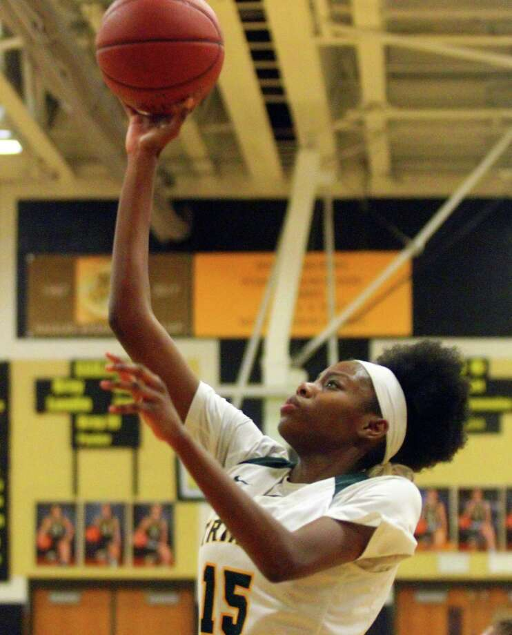 Trinity Catholic's Iyanna Lops had 29 points, 16 rebounds and 8 blocks in Tuesday's FCIAC semifinal win over Ridgefield. Photo: Christian Abraham / Hearst Connecticut Media / Connecticut Post