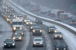 Northbound traffic moves slowly along I-95 due to the inclement weather Wednesday, February 20, 2019, in Norwalk, Conn.