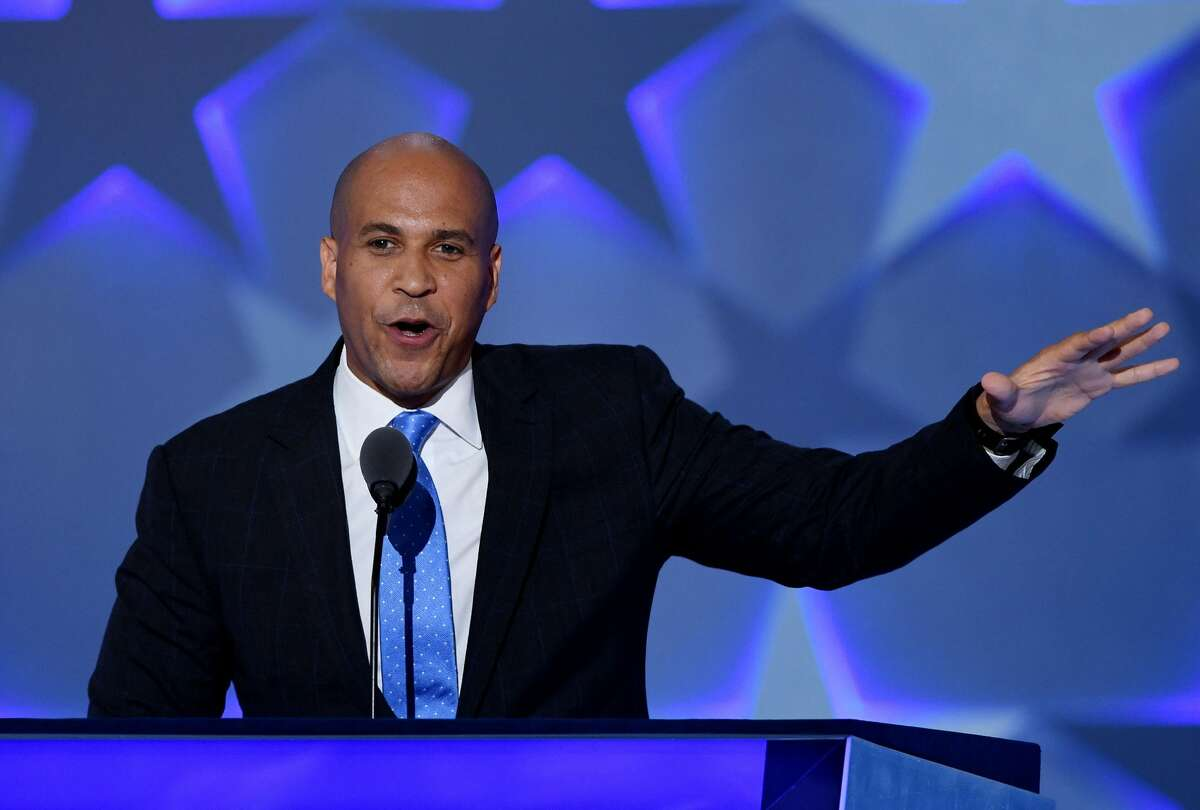 """Who is Cory Booker? New Jersey Sen. Cory Booker, 49, has joined the race for president. """"I believe we can build a country where no one is forgotten, no one is left behind,"""" Booker said in a video announcing his run. """"Where we see the faces of our leaders on television and feel pride, not shame ... together we will channel our common pain back into our common purpose."""" Here's what you need to know about his background, beliefs, controversies and plans for the future."""