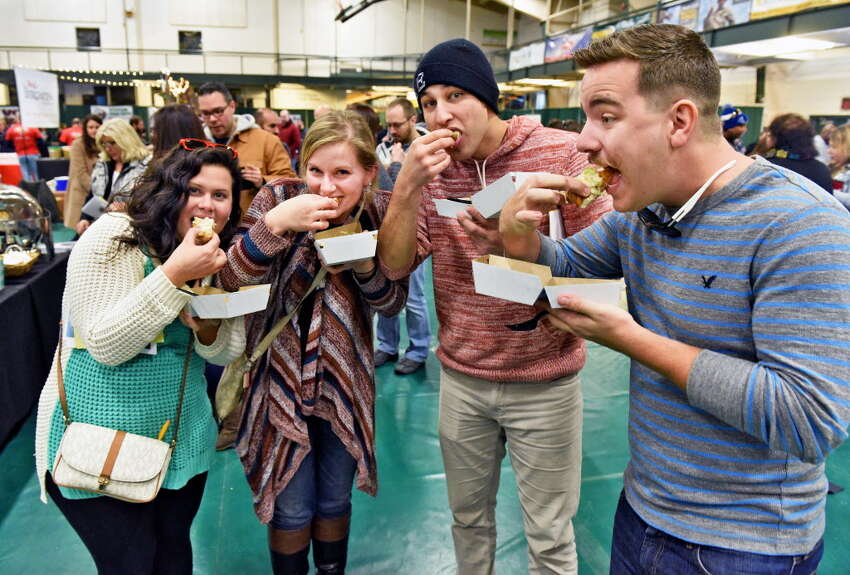 Attendees sample the fare at the Mac-n-Cheese Bowl last winter. The event returns for its 10th anniversary on March 2. (John Carl D'Annibale/Times Union)