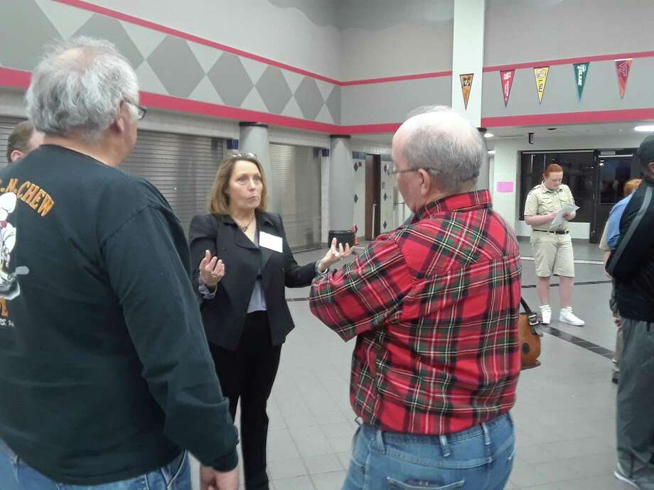 Diane Lindsay with the Harris County Engineering Department, speaks with attendees of the community engagement meeting about the viability of a new bridge on Louetta Road on Feb. 18, 2019. Photo: Chevall Pryce