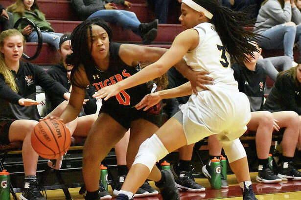 Edwardsville junior point guard Quierra Love looks to drive baseline in the fourth quarter of Tuesday's game against O'Fallon at Belleville West.