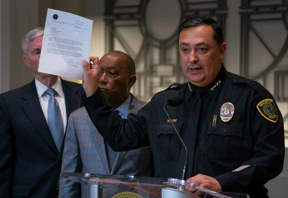 Houston Police Department Chief Art Acevedo holds up a letter from the FBI announcing the bureau's civil rights investigation related to the deaths of two people during the no-knock raid by narcotics officers that killed two people and injured five police officers last month, during a press conference from Houston City Hall, Wednesday, Feb. 20, 2019. Photo: Mark Mulligan, Staff Photographer / © 2019 Mark Mulligan / Houston Chronicle