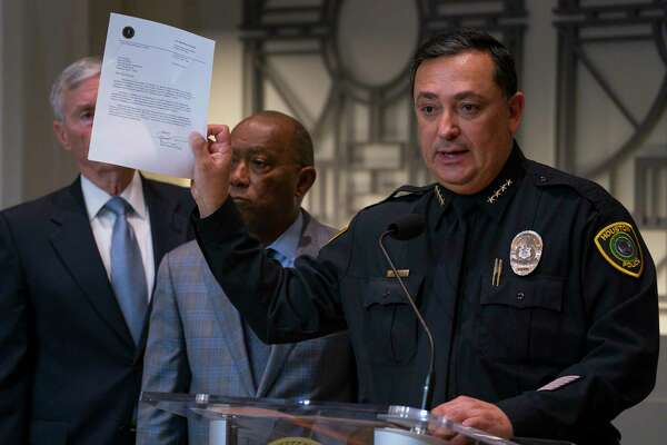 Houston Police Department Chief Art Acevedo holds up a letter from the FBI announcing the bureau's civil rights investigation related to the deaths of two people during the no-knock raid by narcotics officers that killed two people and injured five police officers last month, during a press conference from Houston City Hall, Wednesday, Feb. 20, 2019.