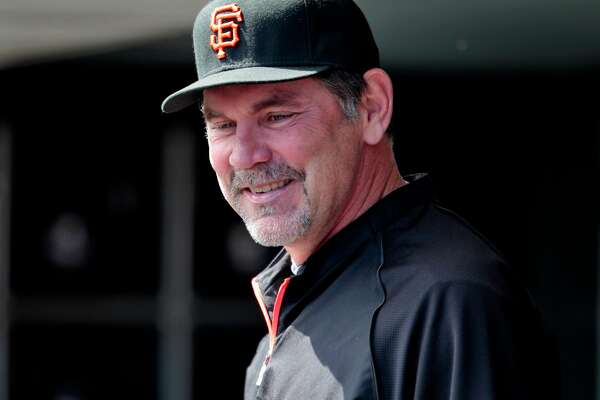 The San Francisco Giants head coach Bruce Bochy in the dugout at the third exhibition games against the Oakland Athletics, Wednesday March 30, 2011, at AT&T Park in San Francisco, Calif.