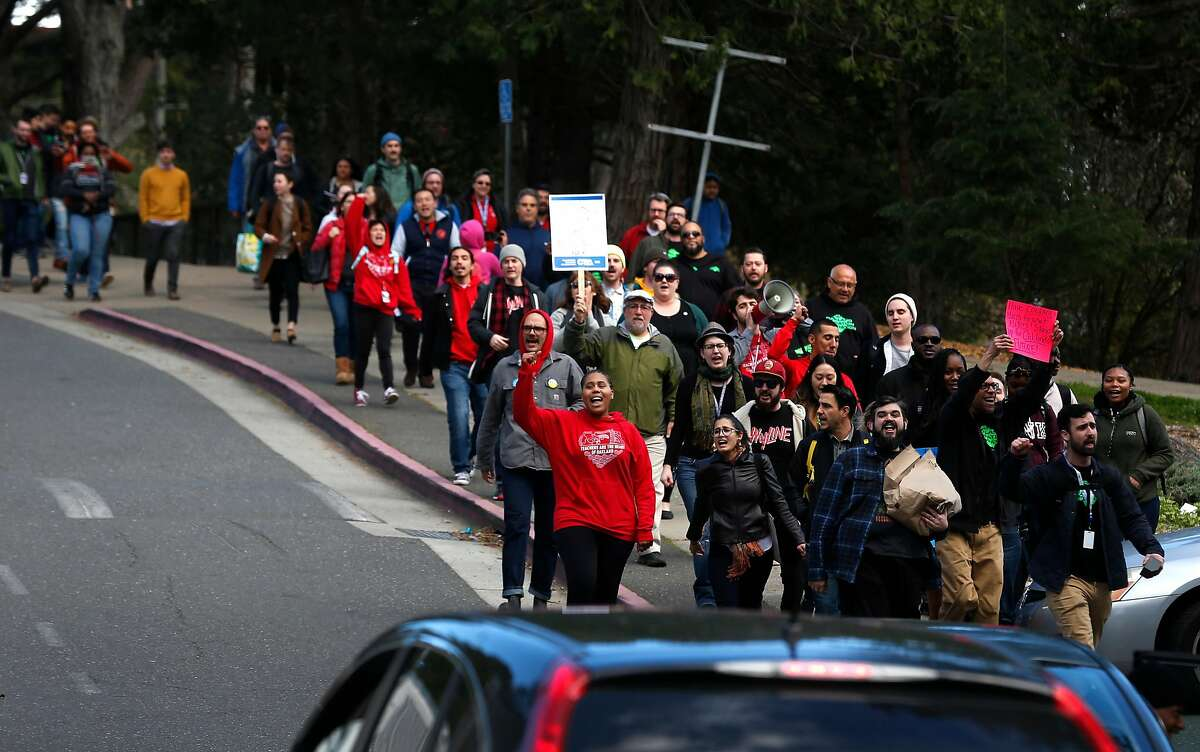 Skyline High School teachers march off campus in solidarity on the eve of a teachers strike against the Oakland Unified School District in Oakland, Calif. on Wednesday, Feb. 20, 2019.