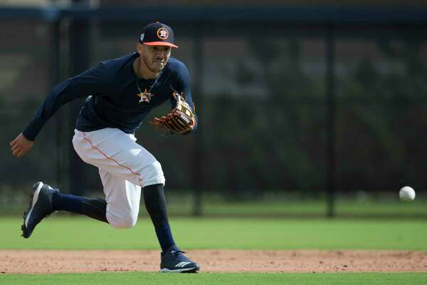 Houston Astros shortstop Carlos Correa (1) runs to catch a ground ball at Fitteam Ballpark of The Palm Beaches on Day 7 of spring training on Wednesday, Feb. 20, 2019, in West Palm Beach.