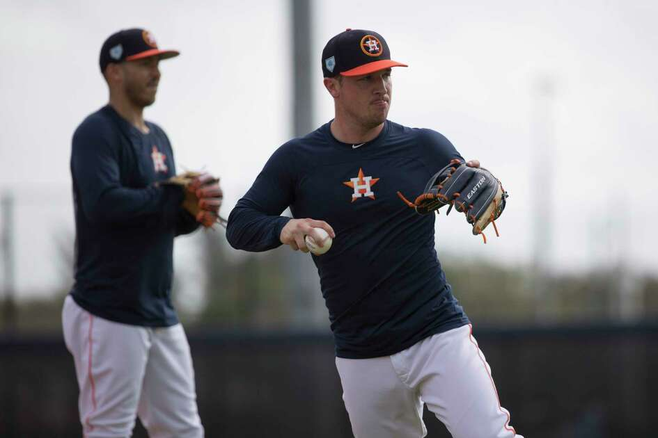 Houston Astros third baseman Alex Bregman (2) and shortstop Carlos Correa (1) work on defense at Fitteam Ballpark of The Palm Beaches on Day 7 of spring training on Wednesday, Feb. 20, 2019, in West Palm Beach.