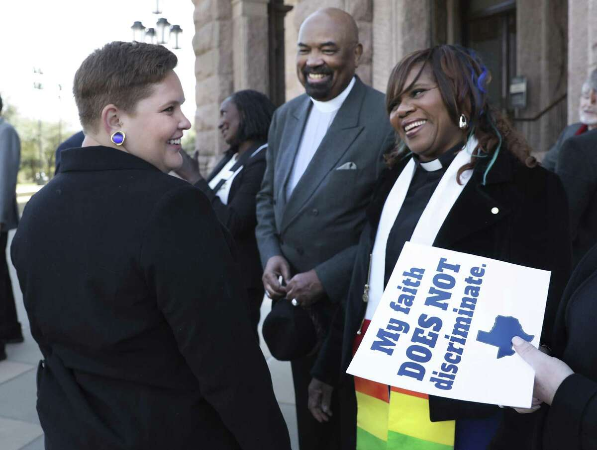 Angela Williams of the Texas Freedom Network, left, talks with Rev. Naomi L. Brown of the Metropolitan Community Church of San Antonio, right, and Rev. Dr. William H. Knight also of the MCC of San Antonio, center at the north entrance to the State Capitol. Faith leaders from Austin, San Antonio, and Dallas gathered to speak against the growing efforts to turn religion into a license to discriminate, and calling for laws that treat everyone including LGBTQ Texans, with equality, fairness and respect, at the State Capitol in Austin, TX, on Wednesday, Feb. 20, 2019.