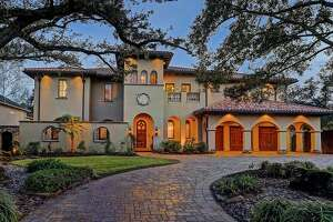 """Located at 5409 Valerie Street, this 9,182 square-foot Bellaire mansion is built like a fortress. In addition to a unique Star Wars-themed media room, the home boasts five bedrooms, six full and two half bathrooms and a """"backyard paradise"""" that includes an outdoor kitchen and living room, pool and spa."""