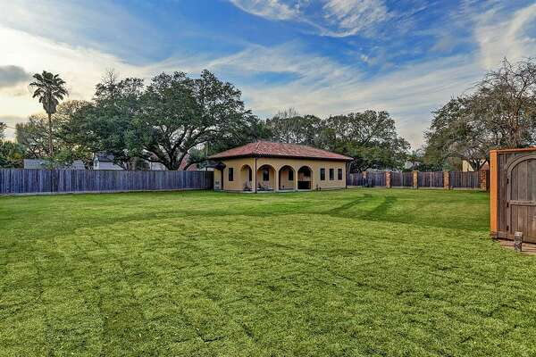 "Located at 5409 Valerie Street, this 9,182 square-foot Bellaire mansion is built like a fortress. In addition to a unique Star Wars-themed media room, the home boasts five bedrooms, six full and two half bathrooms and a ""backyard paradise"" that includes an outdoor kitchen and living room, pool and spa."