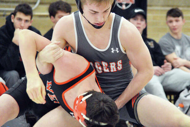 Edwardsville's Will Zupanci, top, takes control of his 145-pound match against Lincoln-Way West on Tuesday in Taylorville.