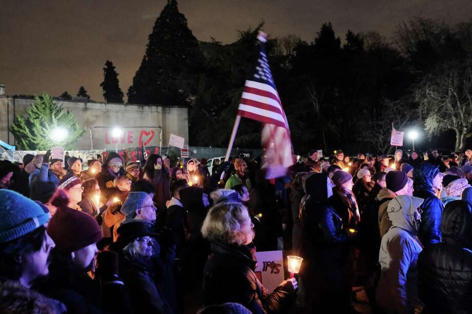 Several hundred people gather to protest President Trump's declaration of a national emergency to fund his border wall, Monday at Volunteer Park in Seattle. The event was part of a National Day of Protest condemning what opponents of Trump are calling a manufactured crisis. Photo: Genna Martin /Seattlepi.com / SeattlePI