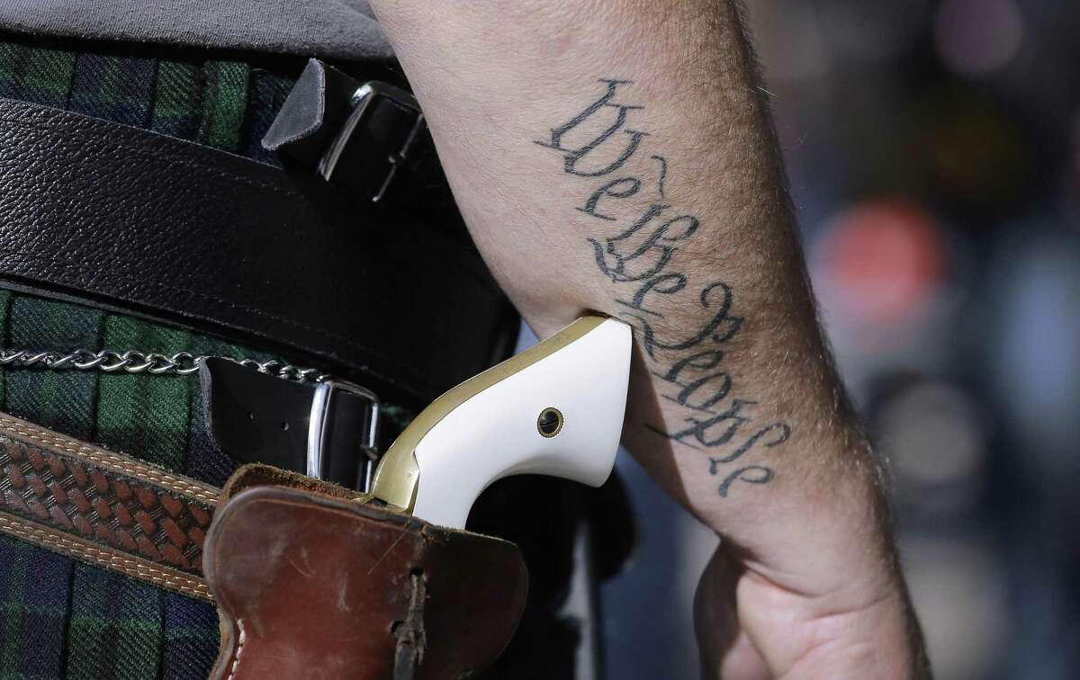 A supporter of open carry gun laws prepares for a rally in Austin. The Texas House and Senate have reached a compromise on a bill to allow the permitless carrying of handguns, the top negotiators said Friday, moving it even closer to Gov. Greg Abbott's desk for a likely signature.