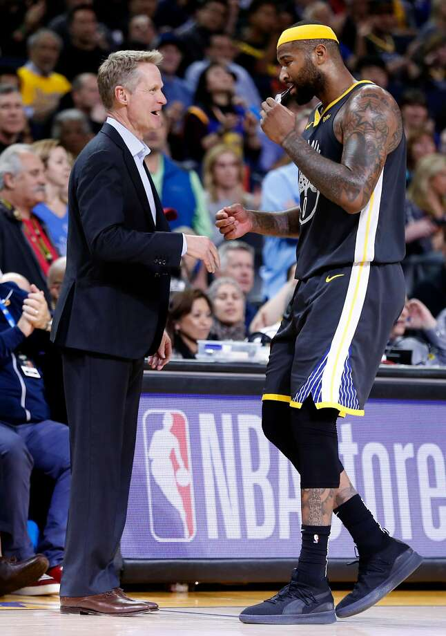 Golden State Warriors' head coach Steve Kerr greets DeMarcus Cousins as he removes Cousins late in 4th quarter of Warriors' 115-108 win over Utah Jazz in NBA game at Oracle Arena in Oakland, Calif., on Tuesday, February 12, 2019. Photo: Scott Strazzante, The Chronicle