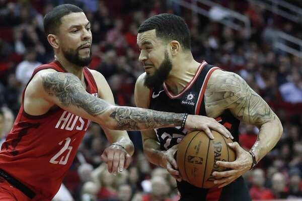 Houston Rockets guard Austin Rivers (25) blocks Toronto Raptors guard Fred VanVleet (23) during the second half of an NBA basketball game at Toyota Center, Friday, Jan. 25, 2019, in Houston.