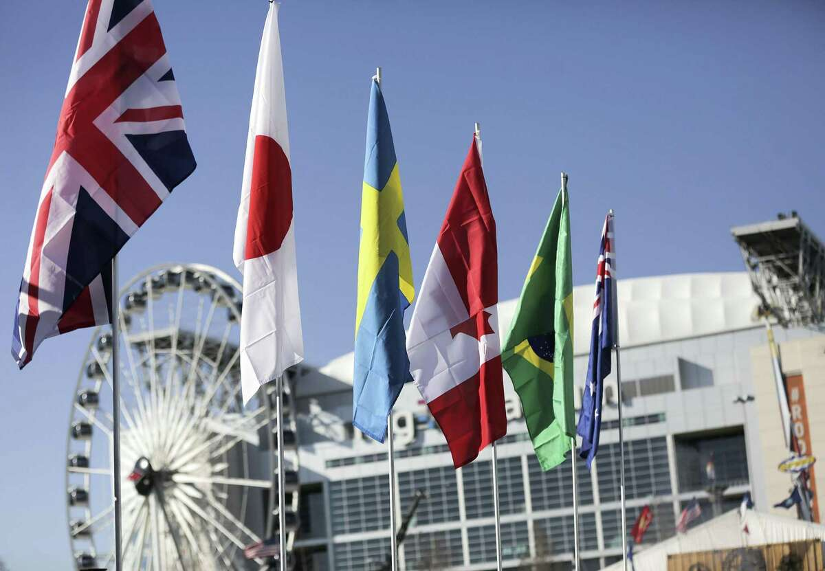 Flags from international teams competing in the 2019 World's Championship Bar-B-Que Contest fly high at NRG on Tuesday, Feb. 20, 2018 in Houston.