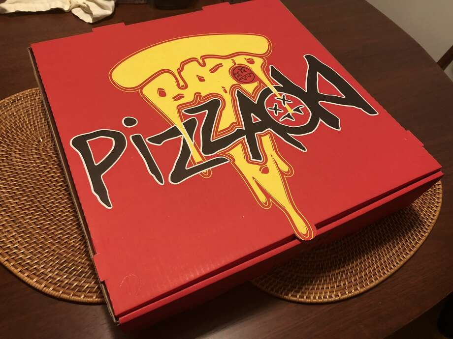 The Pizzaoki box shows a dripping slice of pizza, perhaps a hint at the soggy mess that lies inside. Photo: Alix Martichoux / SFGATE