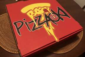 The Pizzaoki box shows a dripping slice of pizza, perhaps a hint at the soggy mess that lies inside.