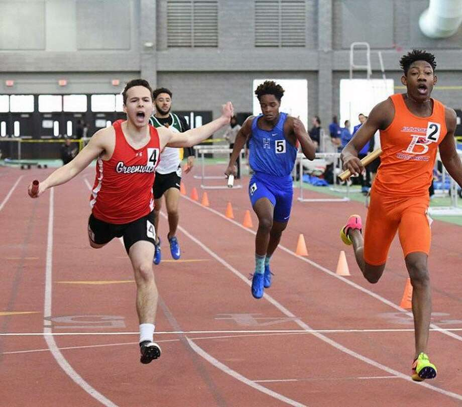 Zane Nye of Greenwich crosses the finish line in the 4x200-meter relay event at the State Open Boys Indoor Track and Field Championships on Saturday, Feb. 16 at the Floyd Little Athletic Center in New Haven. Greenwich placed a close second in the event, behind champion Bloomfield. Photo: Contributed Photo / Contributed Photo / Greenwich Time Contributed