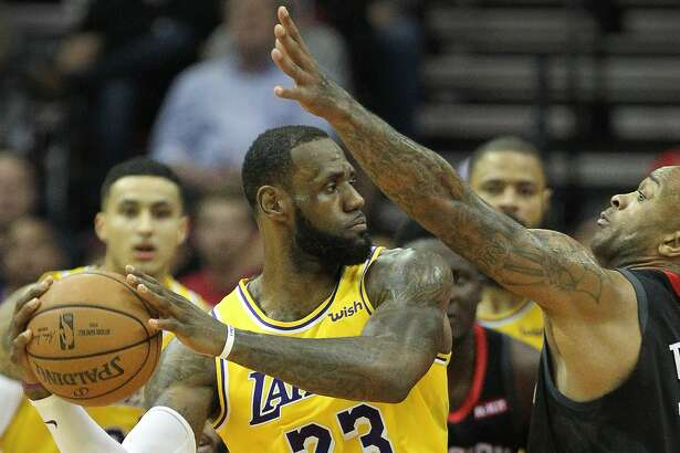 Los Angeles Lakers forward LeBron James (23) battles with Houston Rockets forward PJ Tucker (17) during the first half of an NBA basketball game at Toyota Center on Thursday, Dec. 13, 2018, in Houston.