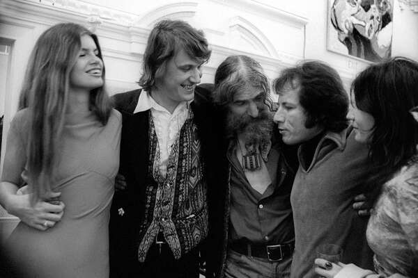 SAN FRANCISCO, CA - MARCH, 1973: Martha Satty, Wilfred Satty and Eugene Schoenfeld talk to friends during the Erotic Art Opening circa March, 1973 in San Francisco, California. (Photo by Robert Altman/Michael Ochs Archives/Getty Images)