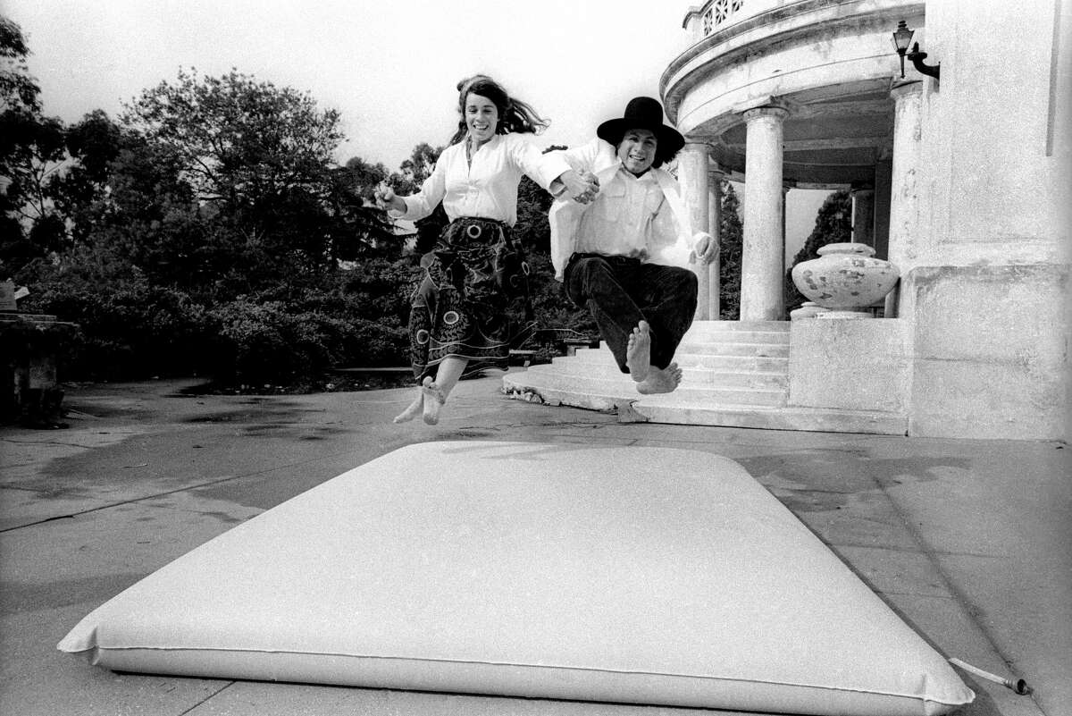 FILE-- Dr. Eugene Schoenfeld and Jamie Huberman test the first waterbed inSeptember1971 in Berkeley. Dr. Schoenfeld had a popular sex and drug column called,
