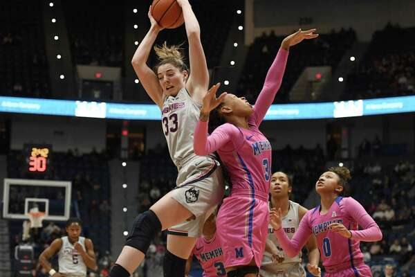 UConn's Katie Lou Samuelson, left, grabs a rebound over Memphis' Ashia Jones, right, during Wednesday's game in Hartford.