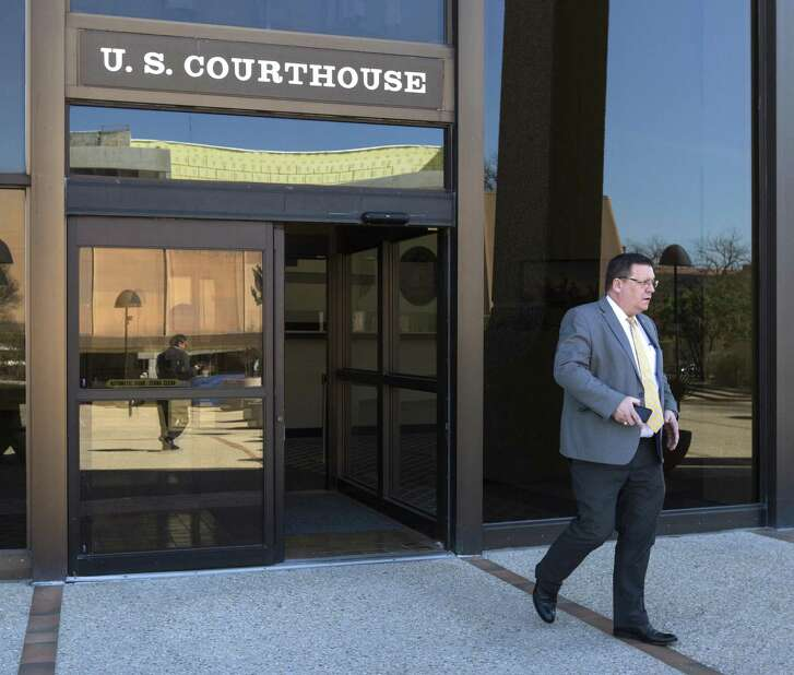Keith Ingram, director of elections at the Texas Secretary of State's office, leaves the John H. Wood Federal Courthouse Tuesday, Feb. 20, 2019 after testifying during a hearing about the stateÕs initiative to purge tens of thousands of Texans from voter rolls who officials claim are not U.S. citizens. The League of United Latin American Citizens has sued the state over the plan and is seeking an injunction to stop the plan.