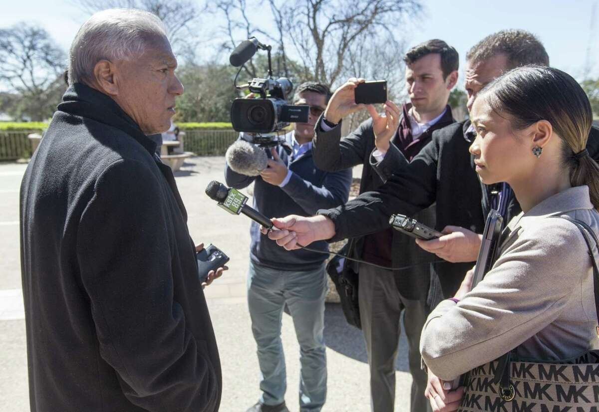 Luis Vera Jr., left, the League of United Latin American Citizens' national general counsel, speaks outside the John H. Wood Federal Courthouse Tuesday, Feb. 20, 2019 to media members after a hearing about the state?•s initiative to purge tens of thousands of Texans from voter rolls who officials claim are not U.S. citizens. The LULAC has sued the state over the plan and is seeking an injunction to stop the plan.