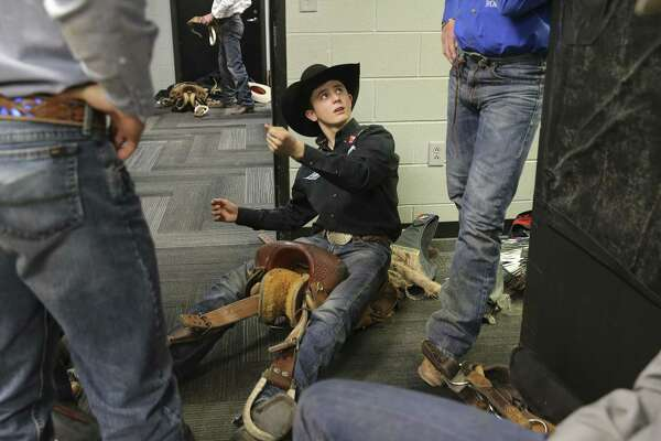 Stetson Wright (center) of Beaver, Utah spends time in the locker room chatting with his uncles as they work on adjusting their saddles for the saddle bronc riding competition at the San Antonio Rodeo on Wednesday, Feb. 20, 2019. Though Wright's family all compete in saddle bronc, the 19-year-old has chosen the path of bull riding instead. (Kin Man Hui/San Antonio Express-News)