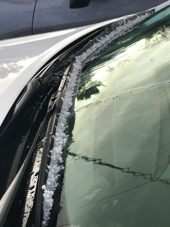 Hailstones gather on a car window in Pleasanton Wednesday afternoon as isolated showers moved through the area. Photo: Hamed A. / Twitter