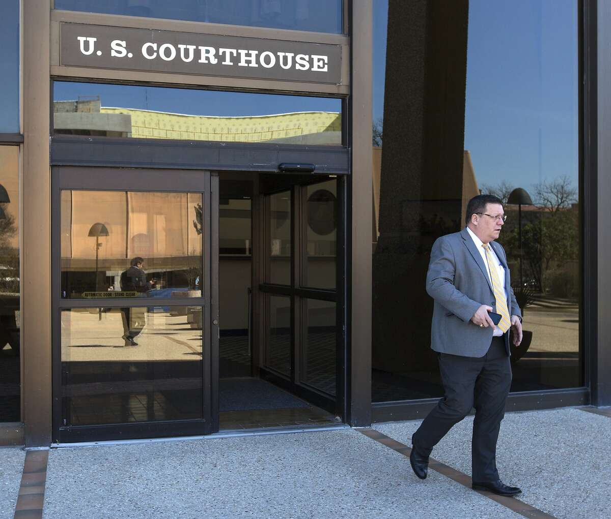 Keith Ingram, director of elections at the Texas Secretary of State's office, leaves the John H. Wood Federal Courthouse Tuesday, Feb. 20, 2019 after testifying during a hearing about the state?•s initiative to purge tens of thousands of Texans from voter rolls who officials claim are not U.S. citizens. The League of United Latin American Citizens has sued the state over the plan and is seeking an injunction to stop the plan.