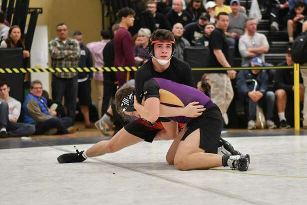 Tommy Mazur of Westhill Vikings and Noah Zuckerman of the Fairfield Warde Mustangs wrestle in the 152lb weight class during the CIAC Class LL finals on Saturday February 16, 2019 at Trumbull High School in Trumbull, Connecticut.