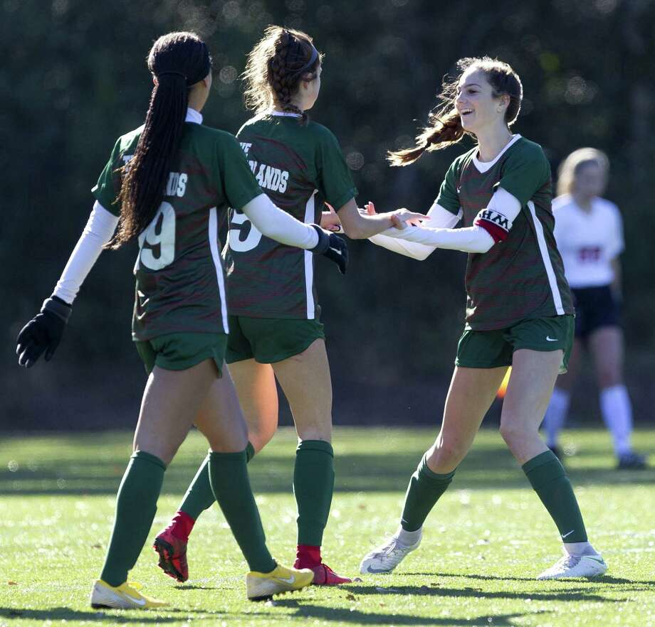 The Woodlands midfielder Marley Krach (5) gets a high-five from forward Tori Vezza during a game in January. Photo: Jason Fochtman, Houston Chronicle / Staff Photographer / © 2018 Houston Chronicle