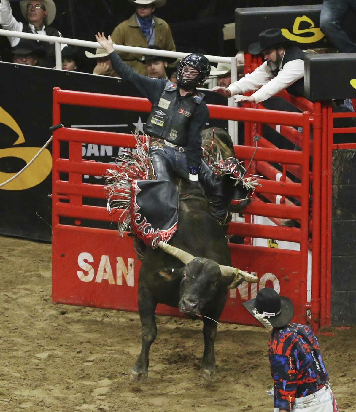 Stetson Wright of Beaver, Utah rides a bull named, House of Pain, at the San Antonio Rodeo on Wednesday, Feb. 20, 2019. Though Wright's family all compete in saddle bronc, the 19-year-old has chosen the path of bull riding instead. (Kin Man Hui/San Antonio Express-News)