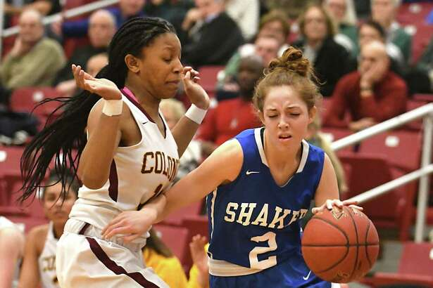 Shaker's Maddy Malicki drives to the basket guarded by Colonie's Lashia Ricketts during a Class AA girls' basketball semifinal on Monday, Feb. 26, 2018 in Guilderland, N.Y. (Lori Van Buren/Times Union)