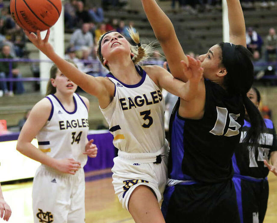 CM freshman Kelbie Zupan (3) shoots around Decatur MacArthur's Quincenia Jackson during Monday's semifinals at the Taylorville Class 3A Sectional. CM plays Springfield SHG for the sectional title on Thursday night. Photo: Greg Shashack / The Telegraph