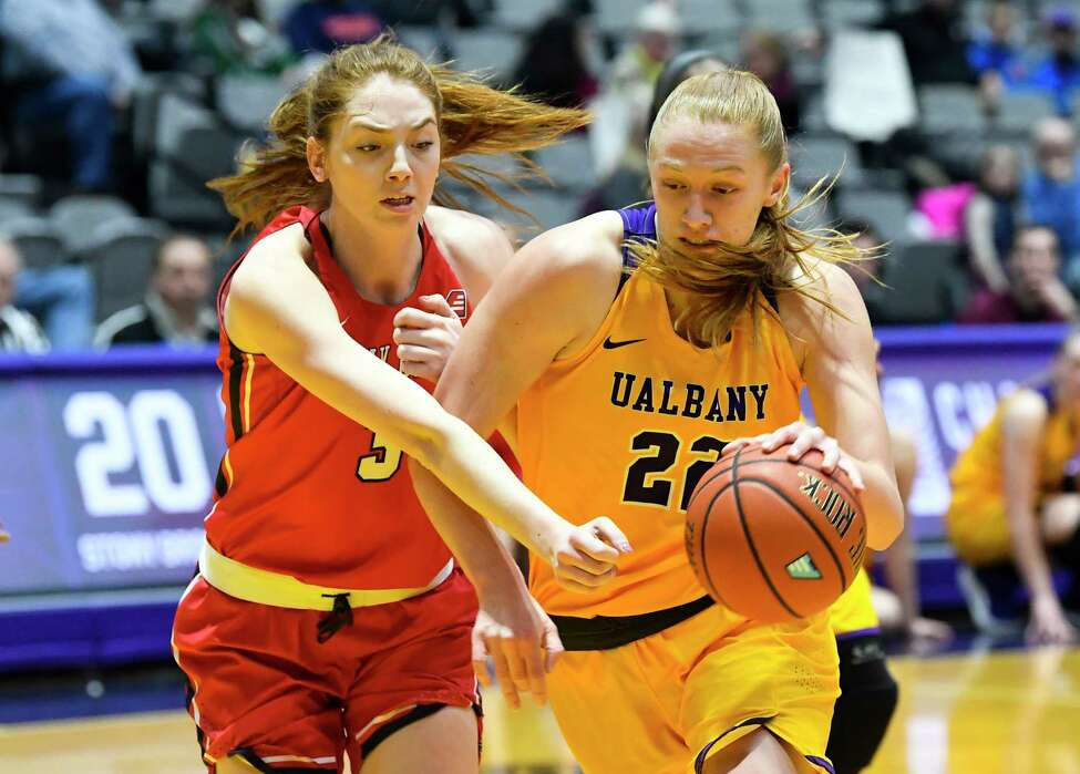 Stony Brook forward Oksana Gouchie-Provencher (3) defends against University at Albany forward Heather Forster (22) during the first half of an NCAA college basketball game Wednesday, Feb. 20, 2019, in Albany, N.Y. (Hans Pennink / Special to the Times Union)